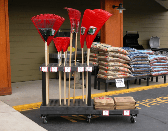 wheeled card holding yard rakes and gardening supplies