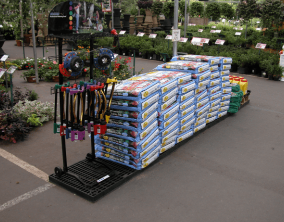 plastic stand holding gardening supplies