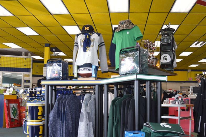 College fan apparel on display in a clothing store