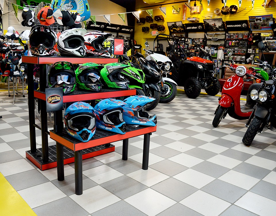 helmets displayed on plastic three-tier display