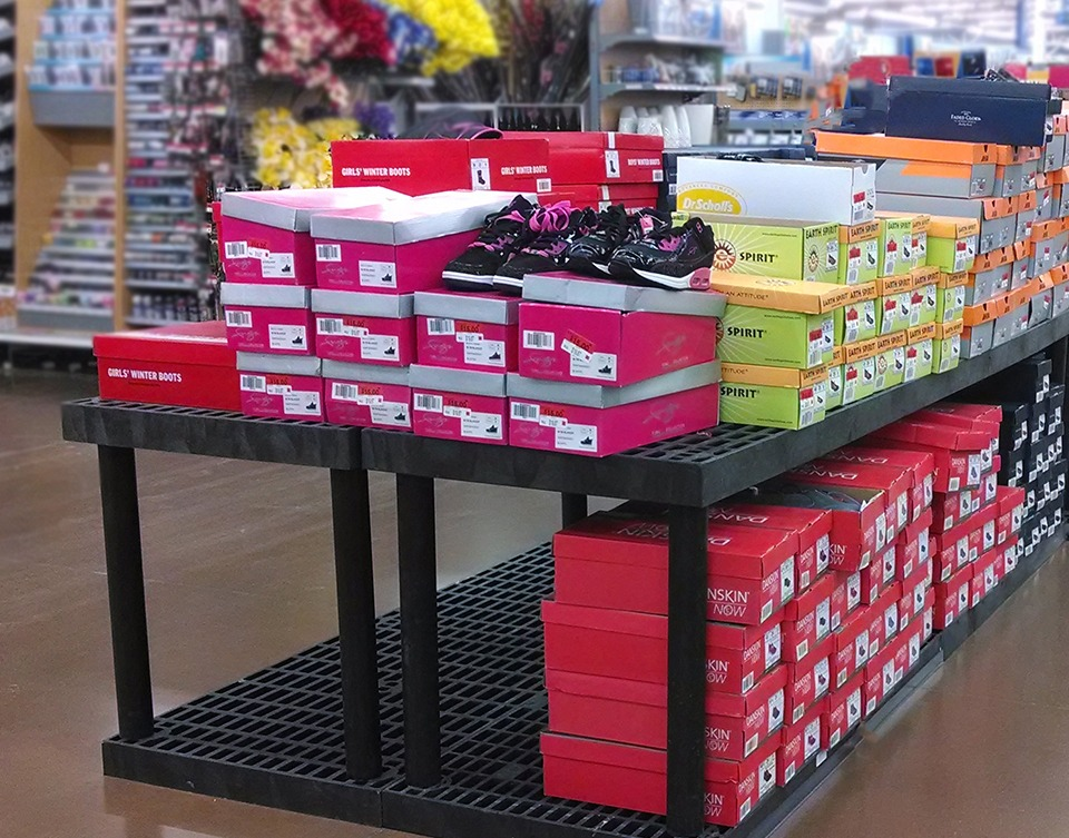 plastic display stand holding shoes