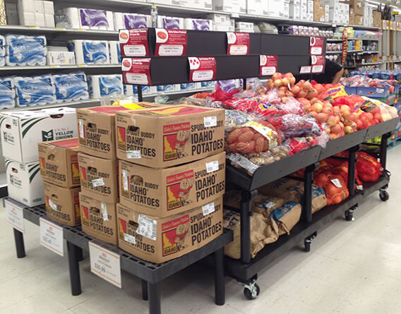 Grocery store display with potatoes and onions