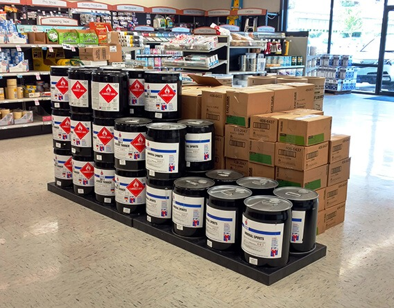 Hardware store display with buckets and boxes