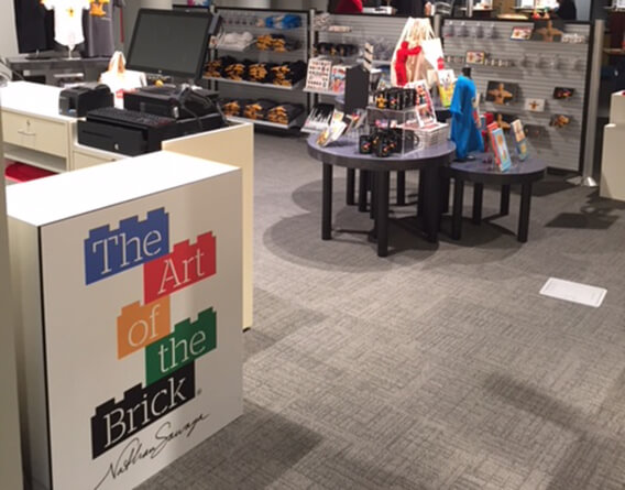 The art of the brick pop up store with products on display