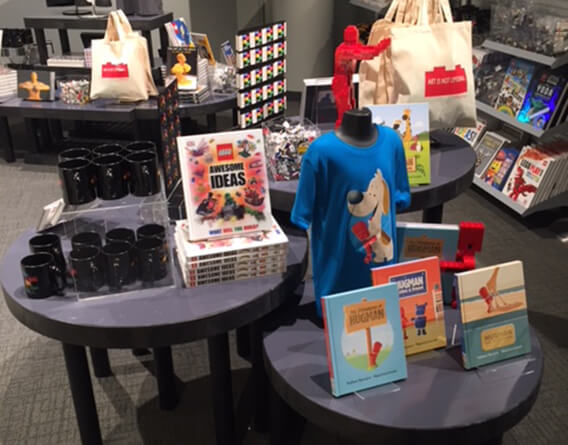 Multiple displays with books, shirts, coffee cups and toys