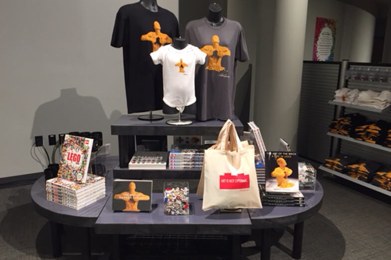 Displays with books, t-shirts and reusable bags