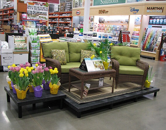 Display with outdoor furniture and plants