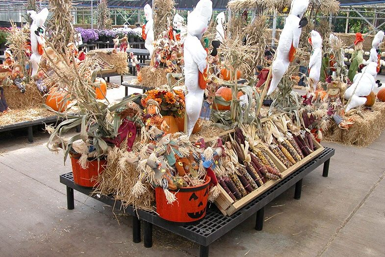 Fall seasonal display with maze, scarecrows and ghost decorations