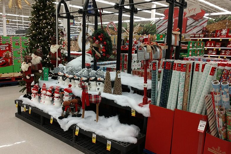 Holiday display with fake snow, snowman and pine trees