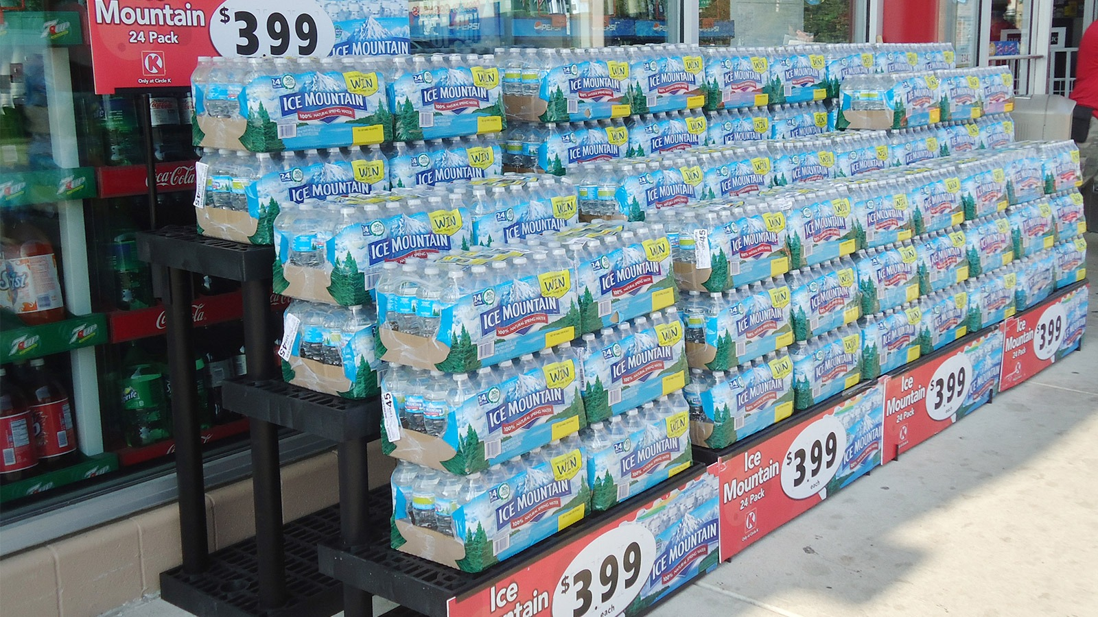 Exterior display with cases of water.