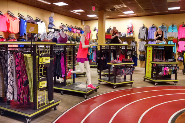 Multiple sportswear displays around an indoor track