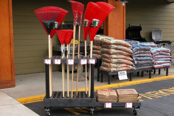 Display of rakes in front of a hardware store
